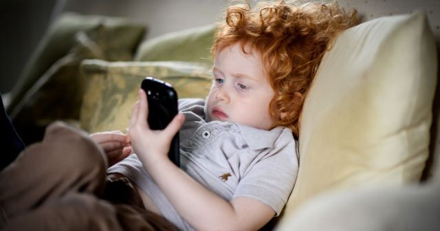 Young_child_using_phone